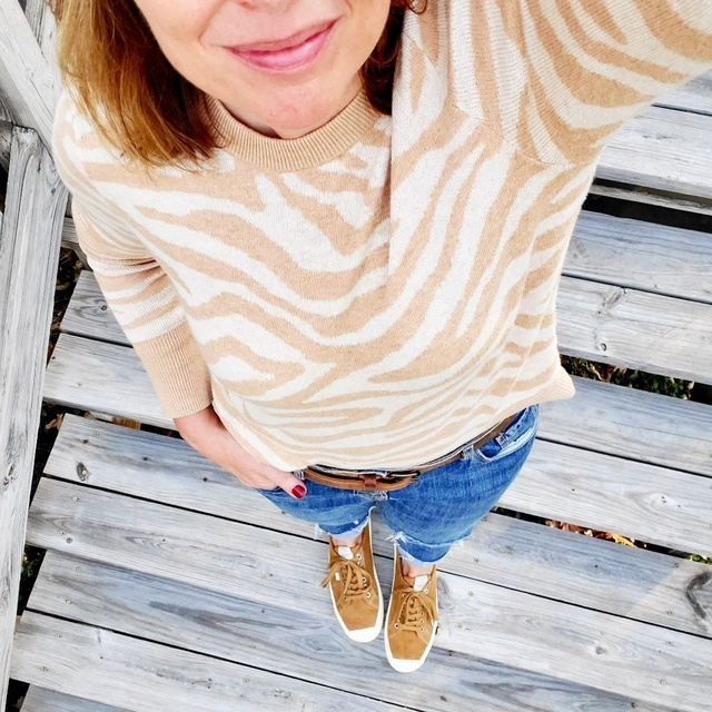 er print sweater, straight jeans, and suede sneakers #ShopStyle #MyShopStyle #Holiday #Winter #zebra #jeans #casual #neutrals