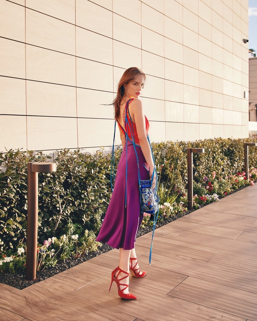 This Prabal Gurung dress spoke to me when I saw it. The mix of purple, blue, and red is so unexpected but just works so well with this piece. I went all out, pairing the dress with red scrappy pumps and a beaded bucket bag, which is big for spring. #ShopStyle #MyShopStyle #LooksChallenge #ContributingEditor #Party #Vacation #Travel