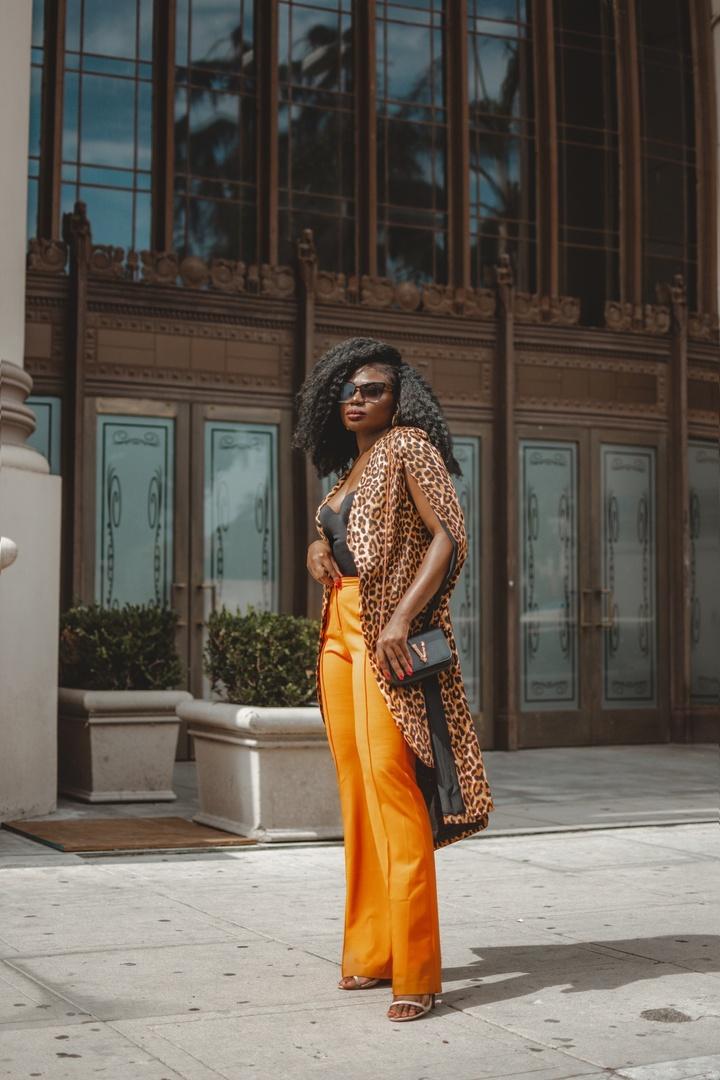 Look by Niké Ojekunle featuring Versace VERSACE Leather Tribute Crossbody Bag in Black & Gold   FWRD