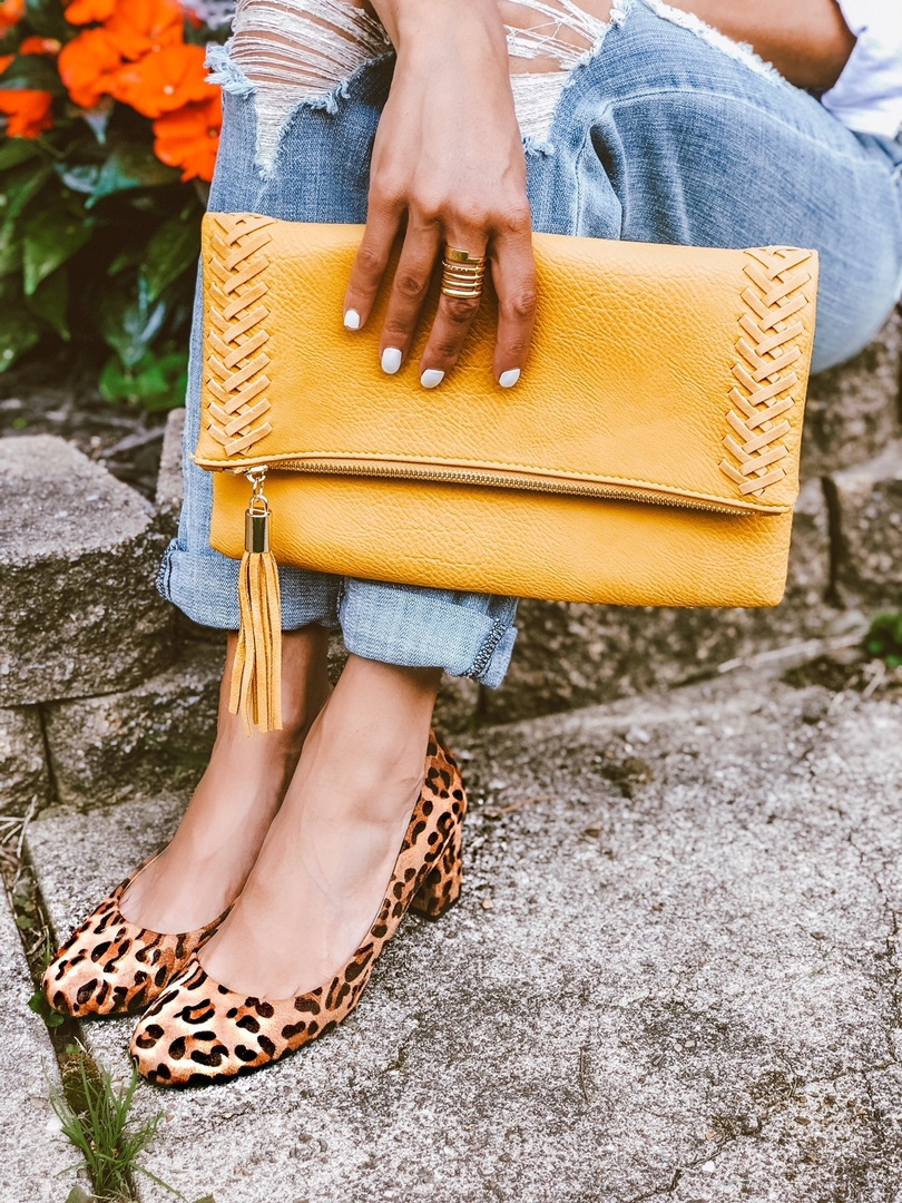 You can never go wrong with a little leopard.            clutch, yellow clutch, kitten heel, white nails, distressed denim, leopard shoes, leopard heels, gold ring #mystyle #summerstyle #momfashion #budgetstyle #fallfashion #leopard