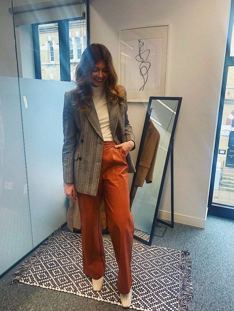 en up your tonals by adding a statement piece like some pleather terracotta trousers. #leathertrousers #tailoring #creamboots