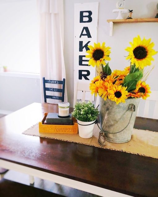 nflower tablescape with an antique bucket.  Farmhouse table decor ideas. #ShopStyle #shopthelook #summertable #farmhousetable