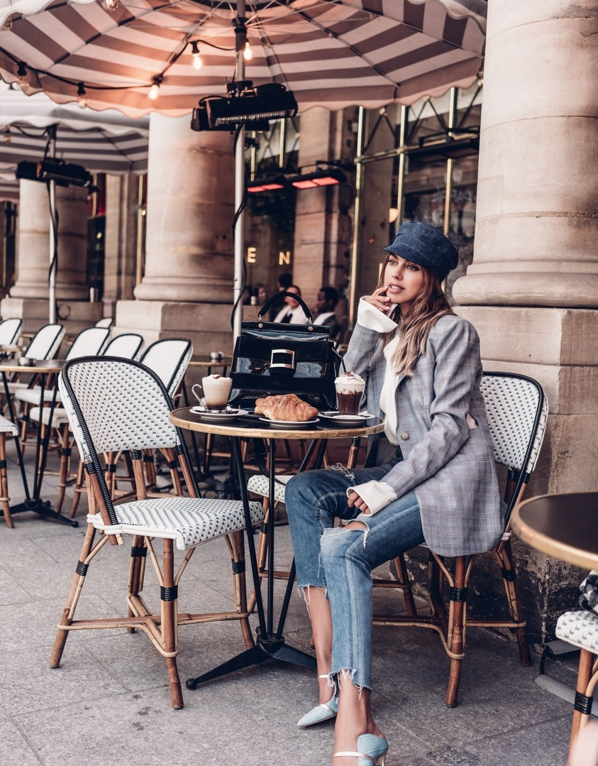 Sitting at a Paris Cafe and people watching - wearing a Tibi blazer, Dior Hat, and Malone Souliers mules