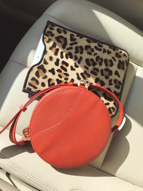 Cuyana mini circle belt bag in blood orange leather