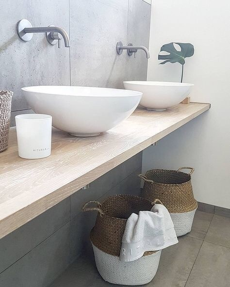 concrete and wood | #woodandconcrete #ad |vesselsink #concrete #wovenbins #everydaydecor #bathroom #moderndesign #minimalist