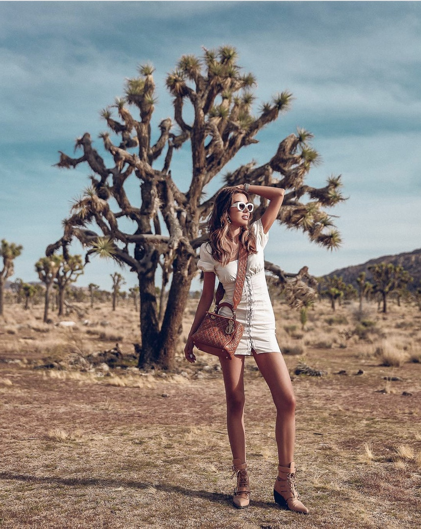Perfect desert outfit idea - cream dress, cutout booties, studded bag, and white sunnies - festival fashion #desert #desertlook #festivalfashion #ootd #ShopStyle #shopthelook #MyShopStyle #FestivalLooks #WeekendLook #OOTD